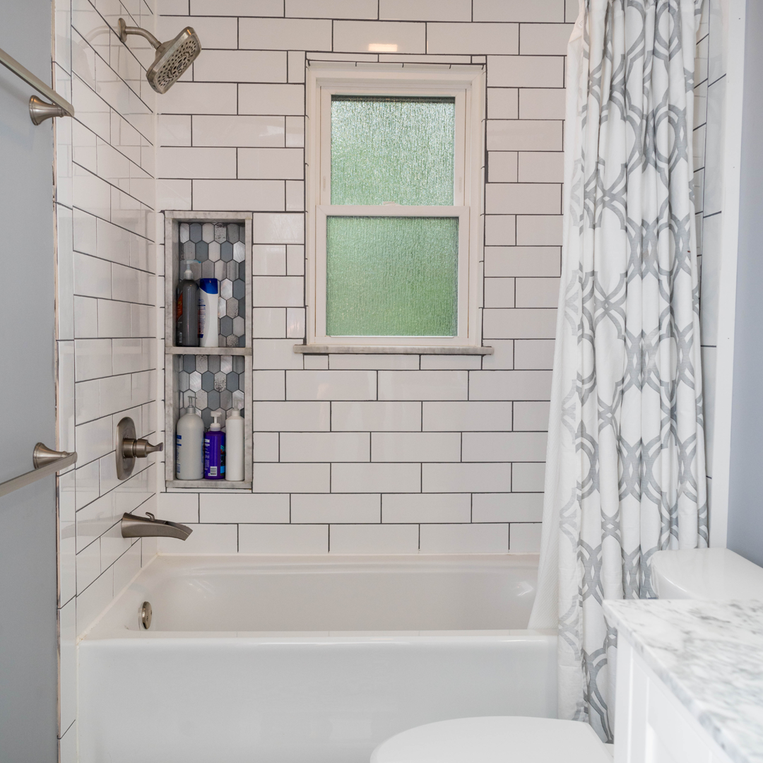 A bathtub and shower