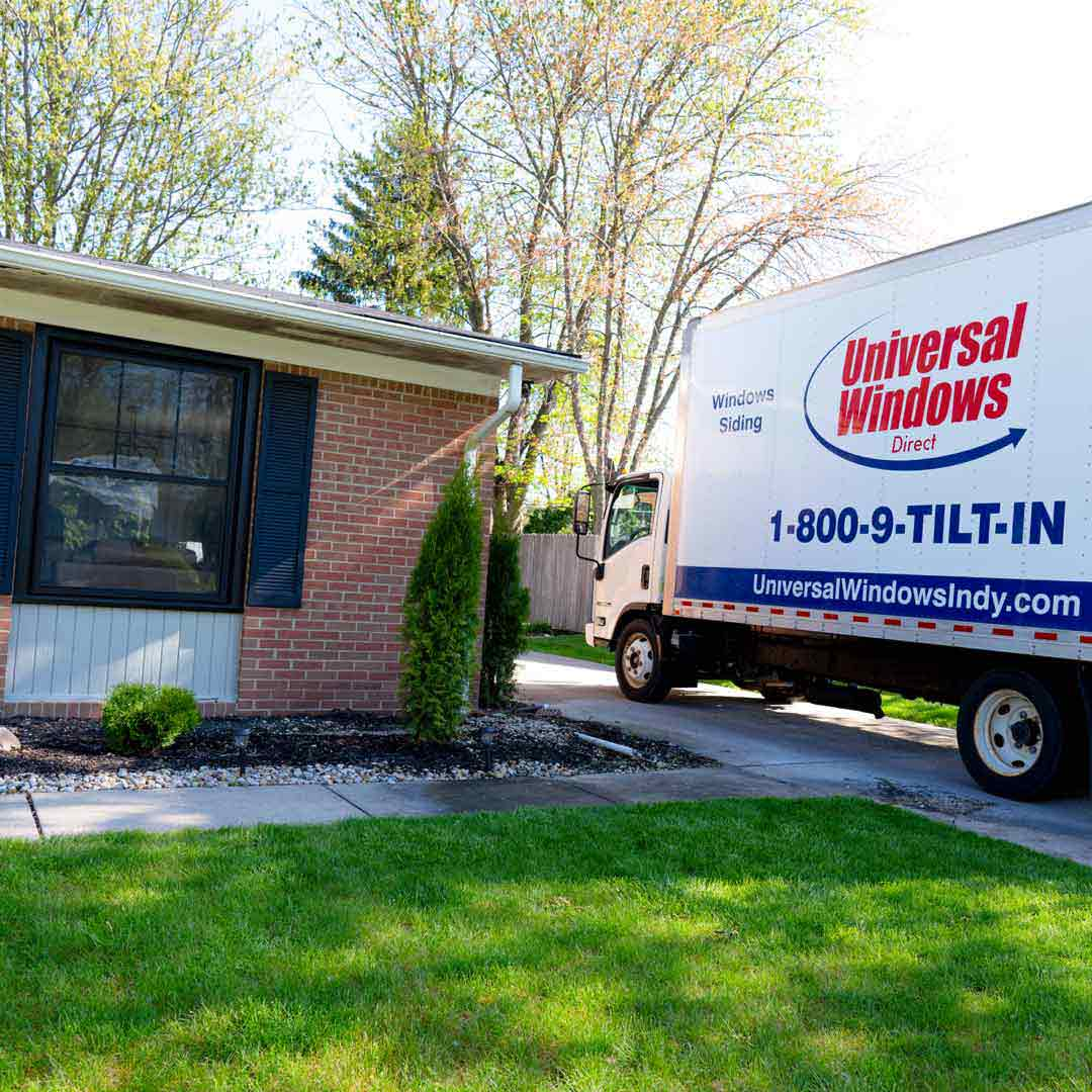 Universal Windows Direct truck in homeowners driveway