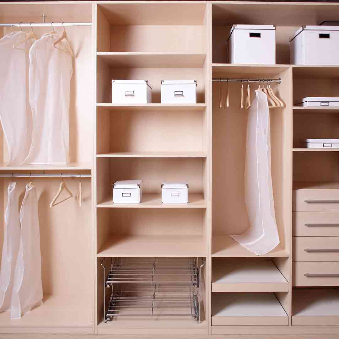walk-in wardrobe organized with boxes and hangers