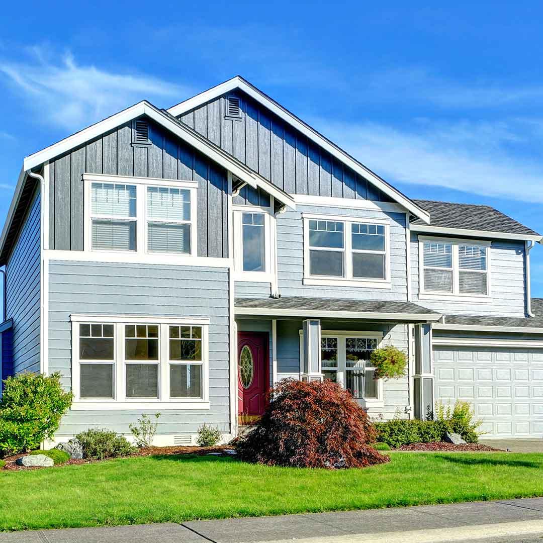 modern blue house in spring