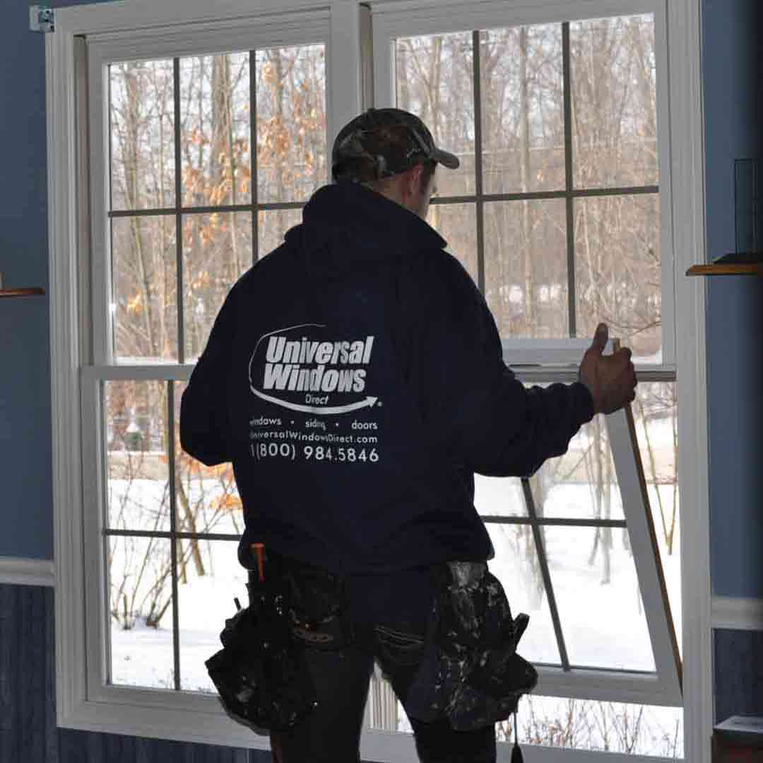 UWD installer installing bottom window sash