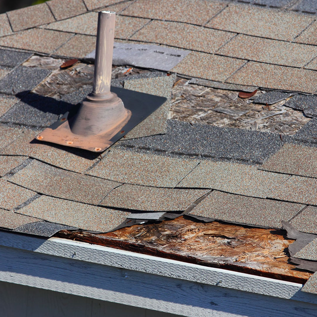 roof with missing shingles, warped shingles, water damaged