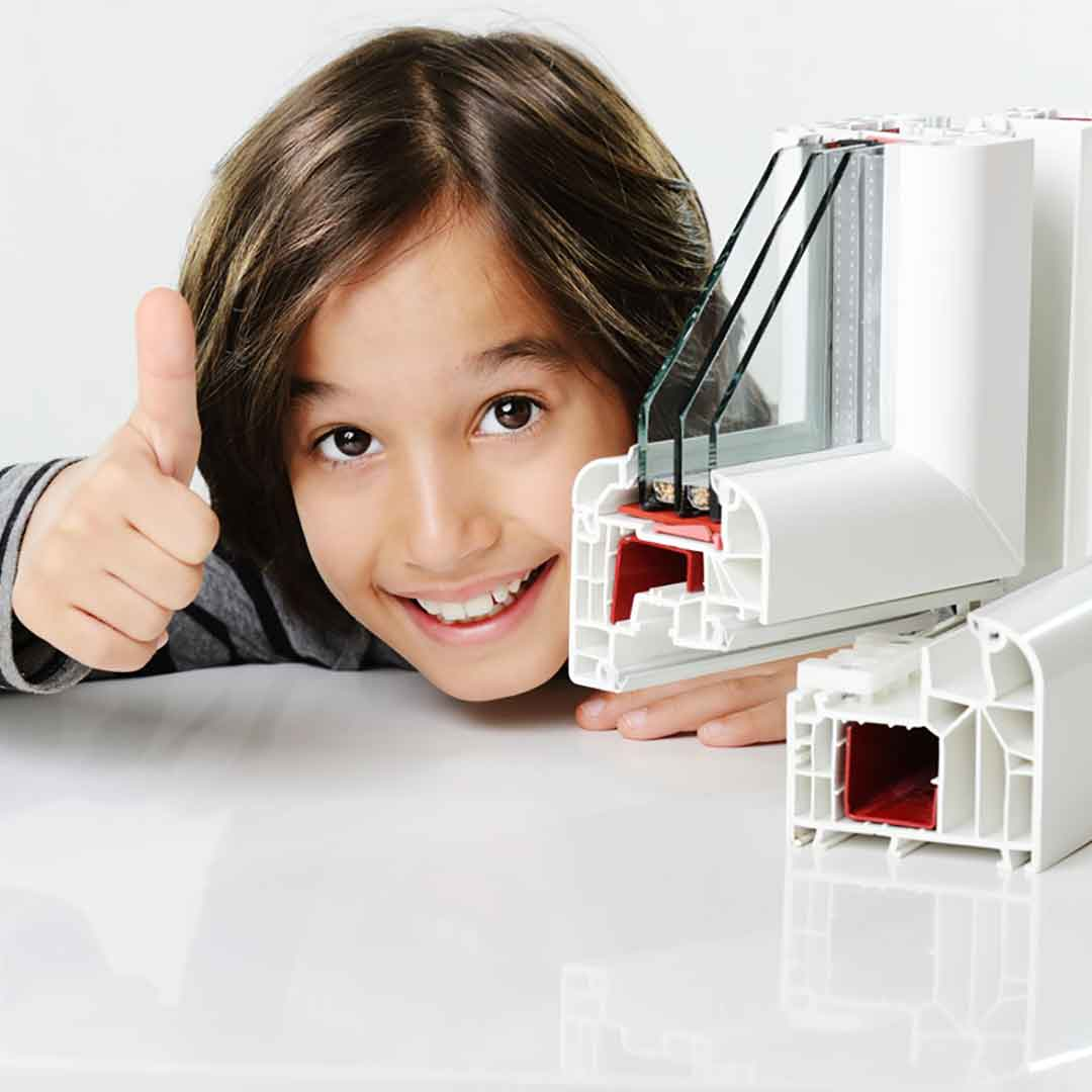 kid gives a thumbs up for triple pane windows